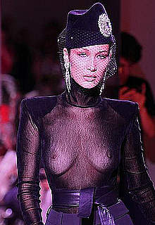 Bella Hadid in see through top runway images