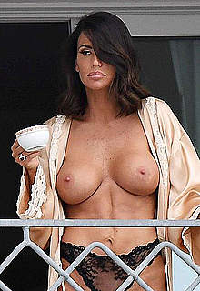 Claudia Galanti topless on a balcony in Italy