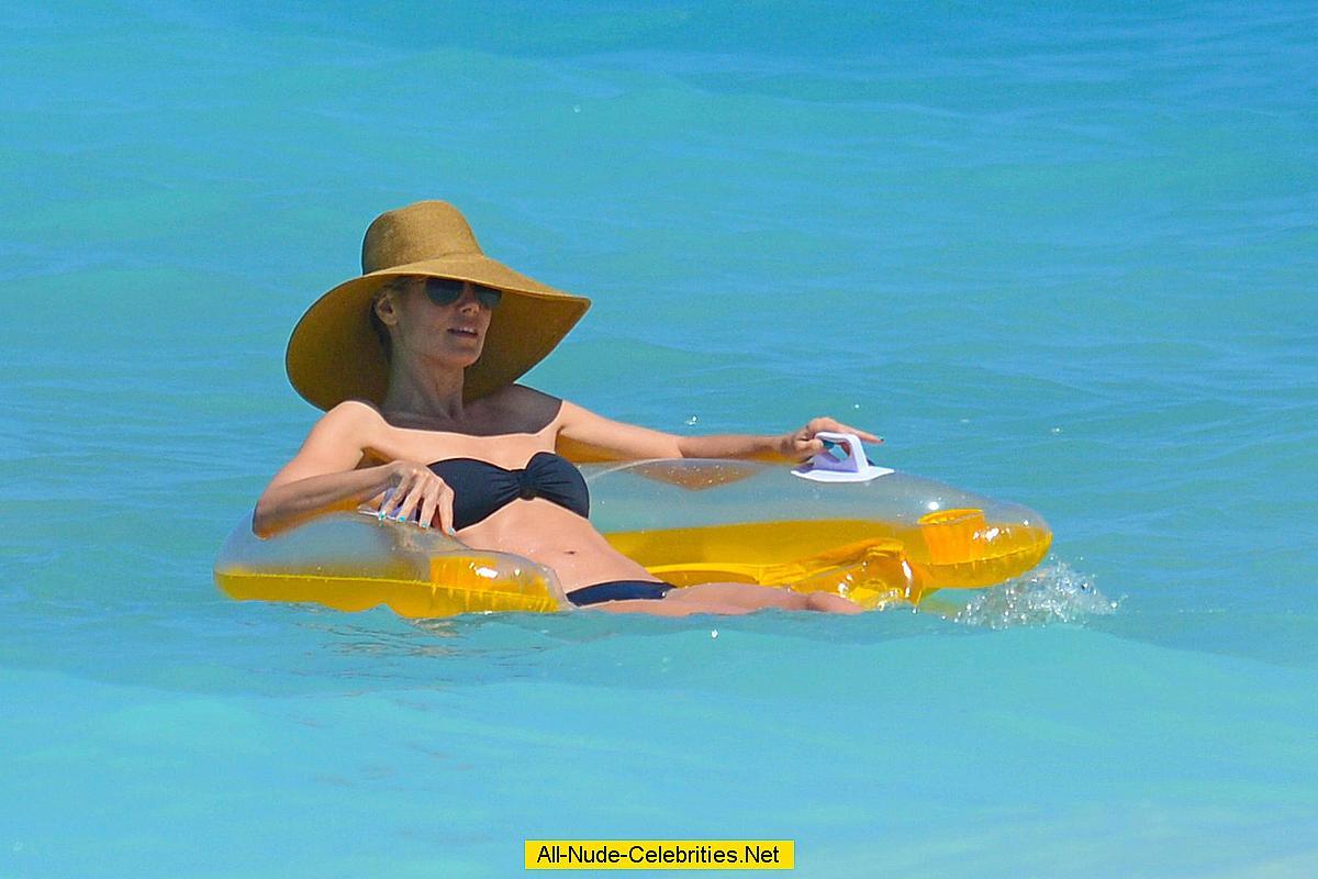 heidi klum wearing black bikini at a beach